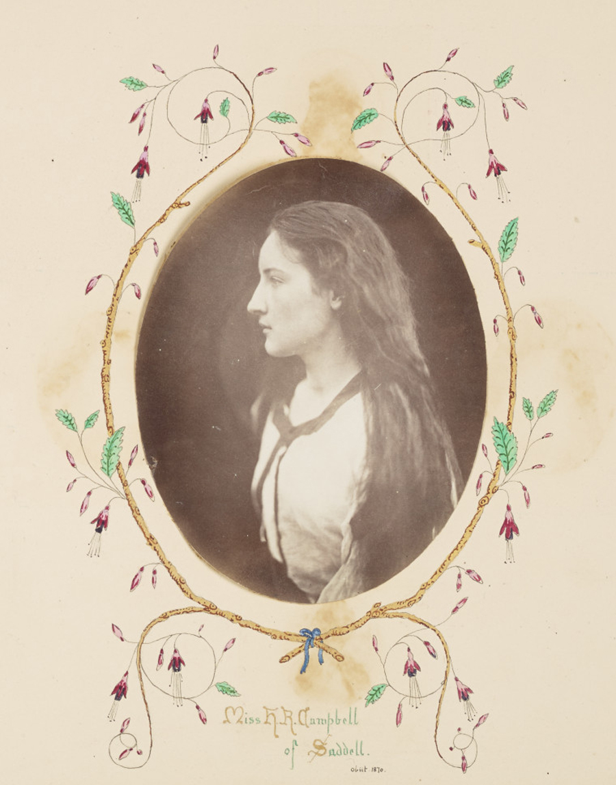 Old portrait of a long haired girl with painted details around the edge.