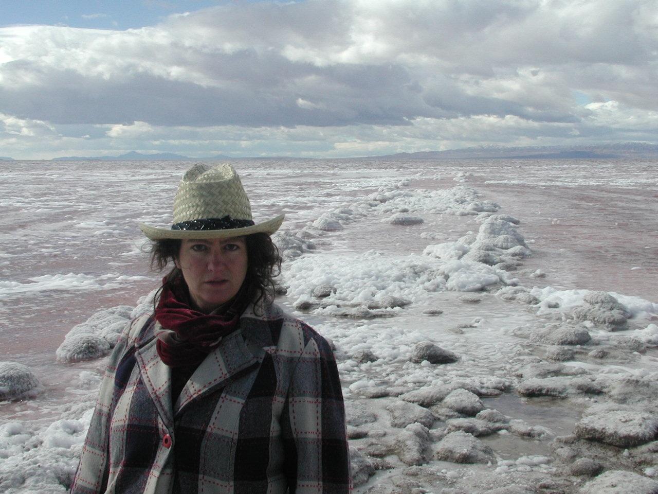 artist standing in salt basin