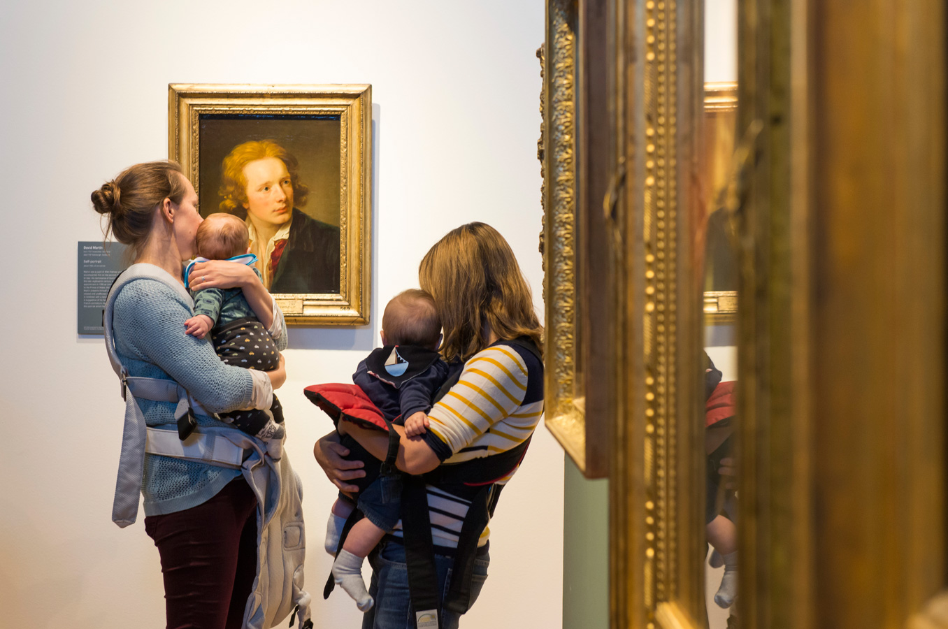 Two mothers with theuir babies at a Bring your own baby session at the Portrait Gallery