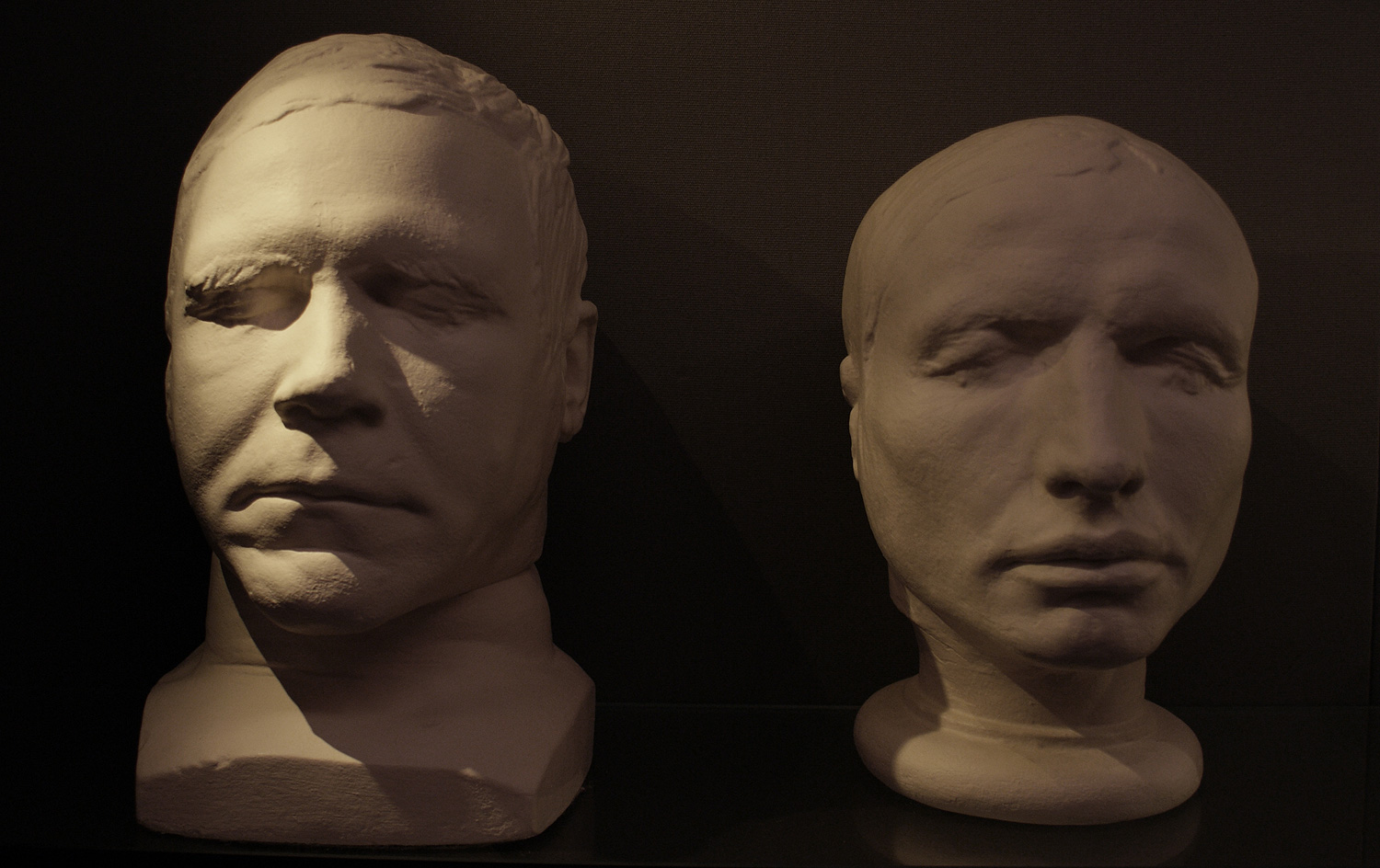 The life and death masks of Burke and Hare displayed on a shelf