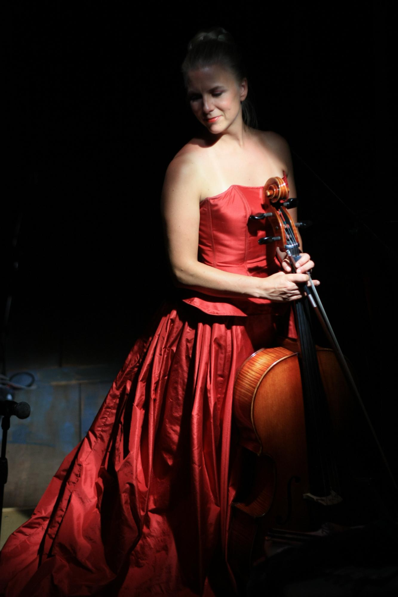 musician in gown holding cello