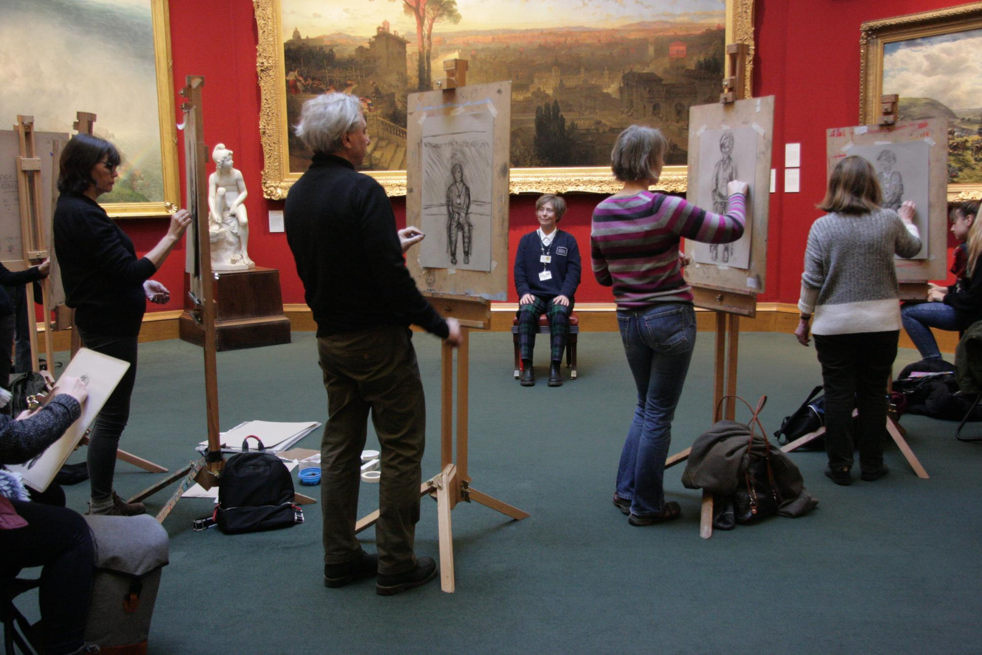 A group sketching on erasels in the Scottish National Gallery