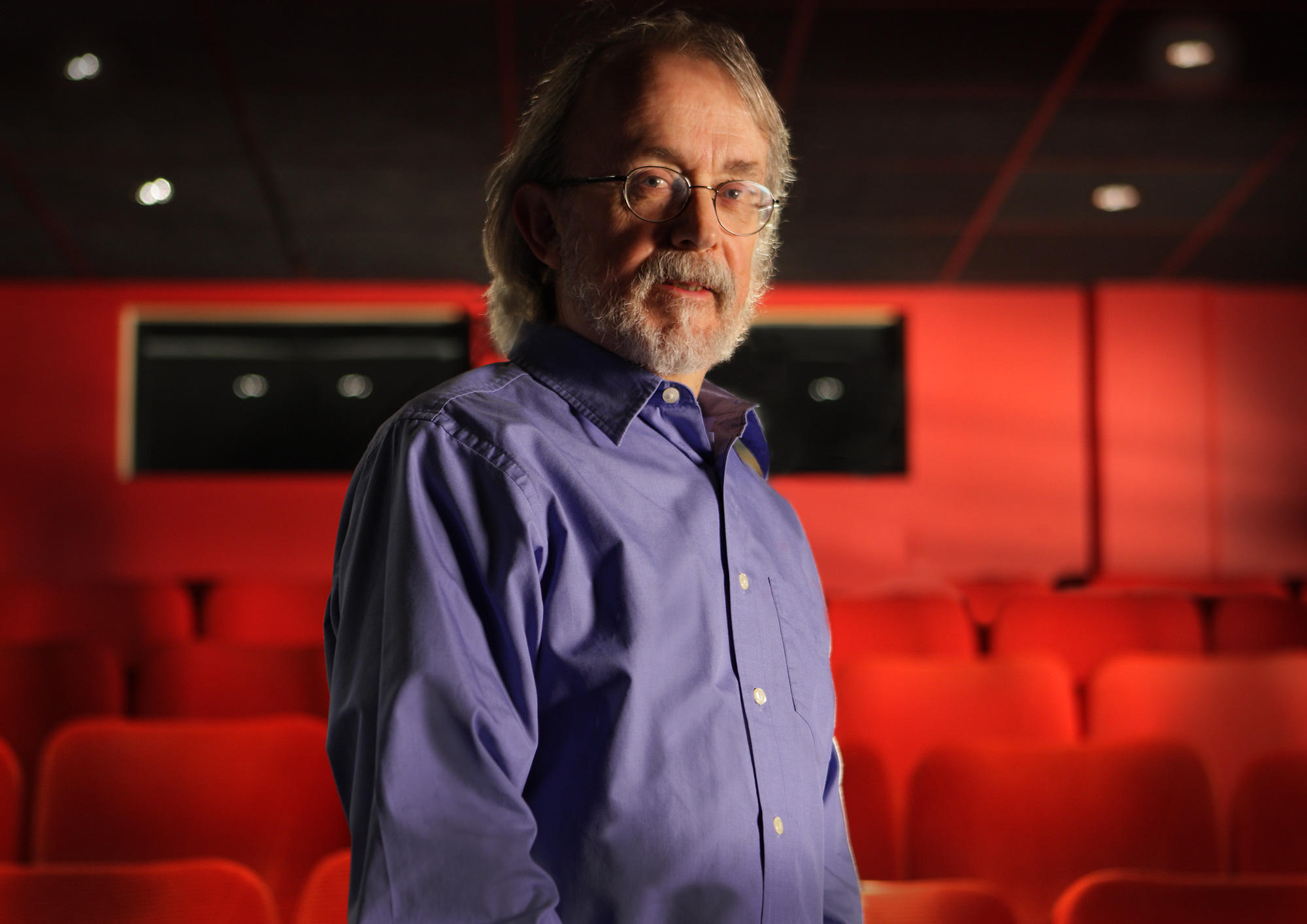 Photograph of Peter Lord standing in a cinema screen room