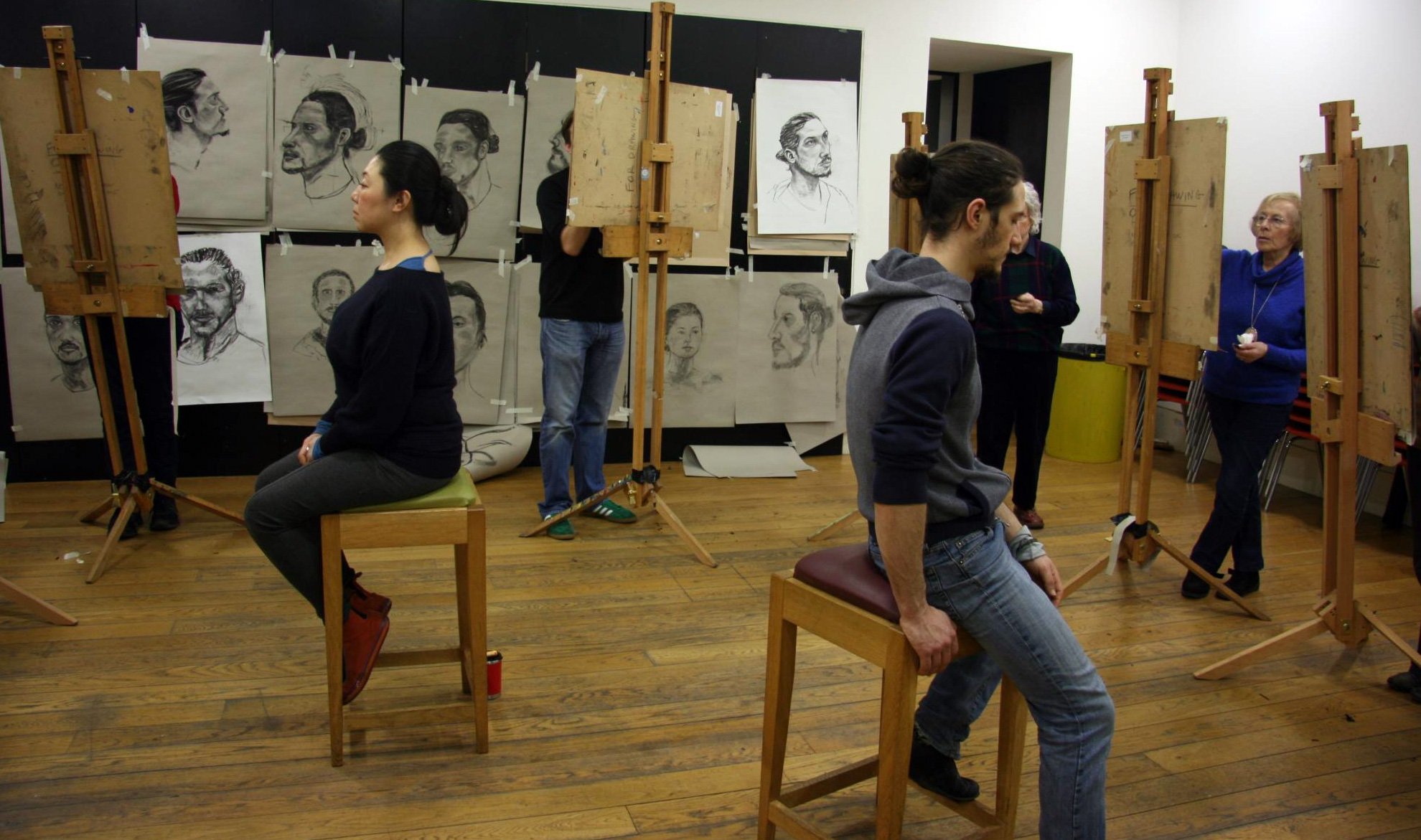 How to draw the human head session with participants at easels and models seated
