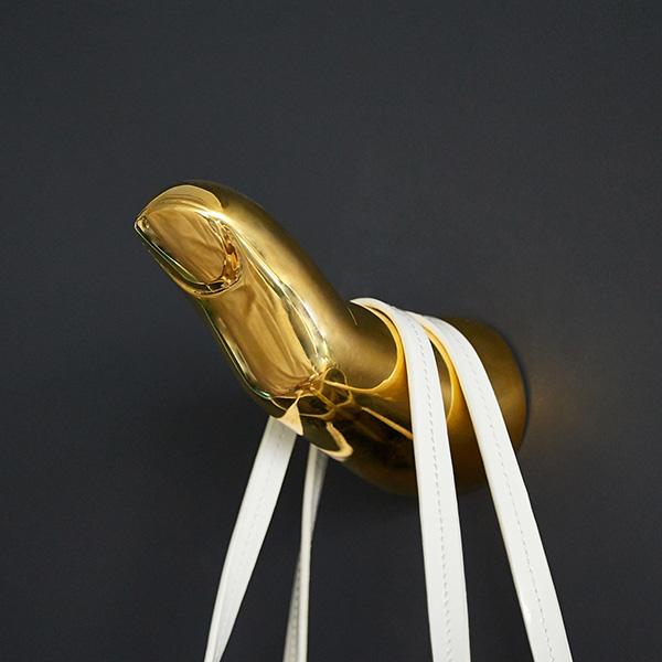 Brass finger coat hook by Jonathan Adler