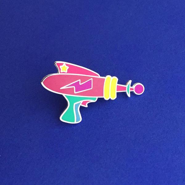 Laser gun enamel pin