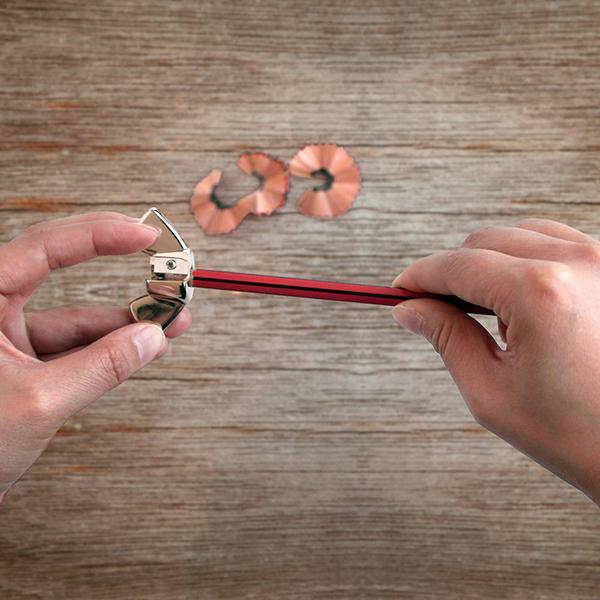 Wing nut pencil sharpener