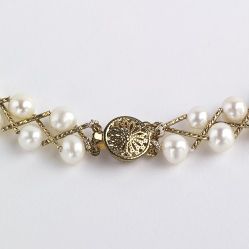 White pearl and gold plated necklace