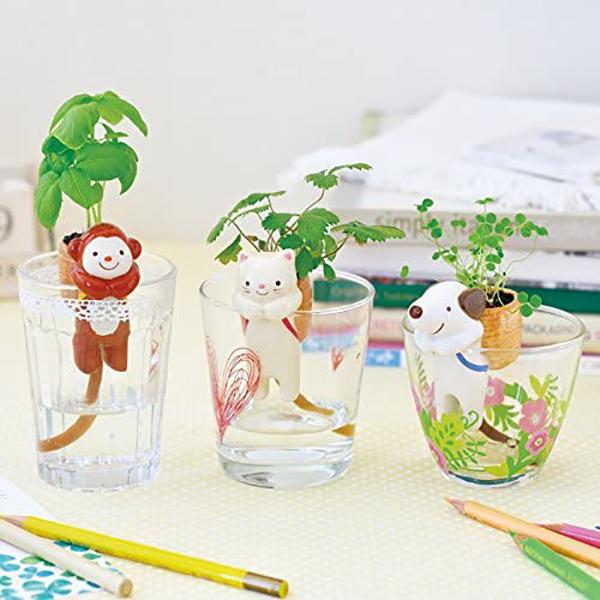 Monkey self-watering planter