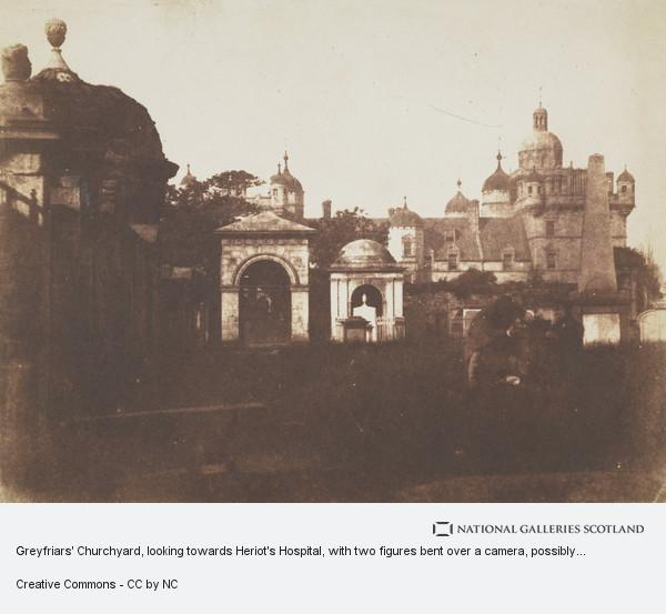David Octavius Hill, Greyfriars' Churchyard, looking towards Heriot's Hospital, with two figures bent over a camera, possibly David Octavius Hill and Robert Adamson ...