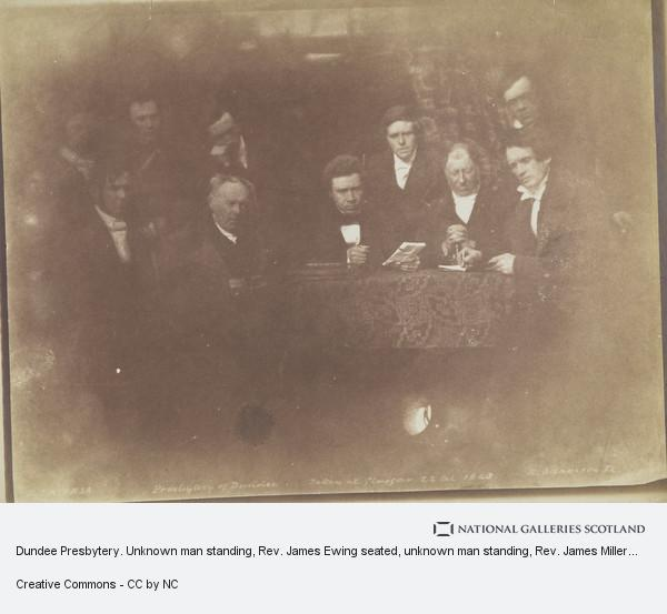David Octavius Hill, Dundee Presbytery. Unknown man standing, Rev. James Ewing seated, unknown man standing, Rev. James Miller seated, unknown man standing, Rev. Dr...