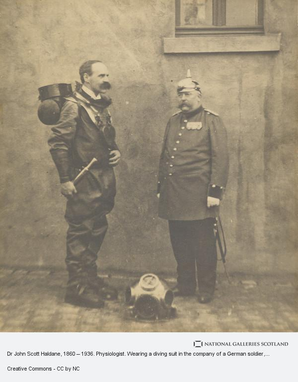 Unknown, Dr John Scott Haldane, 1860 – 1936. Physiologist. Wearing a diving suit in the company of a German soldier