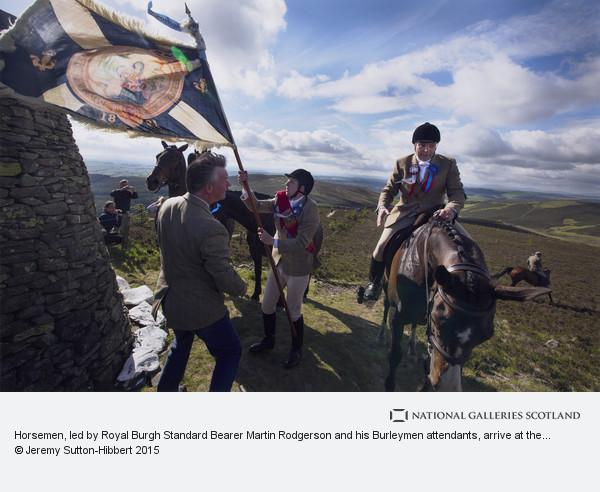 Jeremy Sutton-Hibbert, Horsemen, led by Royal Burgh Standard Bearer Martin Rodgerson and his Burleymen attendants, arrive at the Three Brethren cairns summit, to check...
