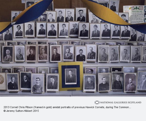 Jeremy Sutton-Hibbert, 2013 Cornet Chris Ritson (framed in gold) amidst portraits of previous Hawick Cornets, during The Common Riding festivities in Hawick, Scotland,...