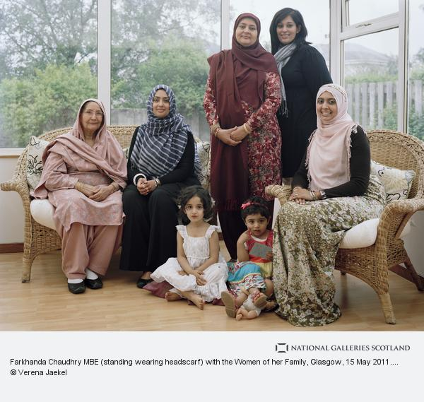 Farkhanda chaudhry mbe standing wearing headscarf with the women of her family glasgow 15 may 2011 from a scottish family portrait series