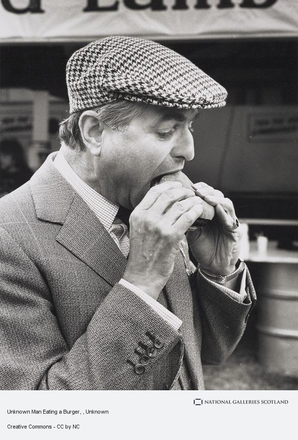 Unknown, Unknown Man Eating a Burger