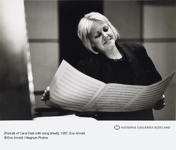 Eve Arnold, [Portrait of Carol Kidd with song sheet]