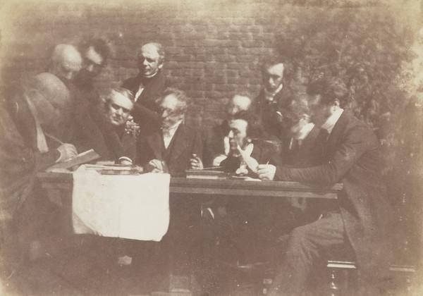 Free Church committee. Rev. Dr Patrick Clason seated, perhaps William Fraser standing, unknown man, Charles Chalmers, unknown man, John Hunter,... (1843 - 1847)