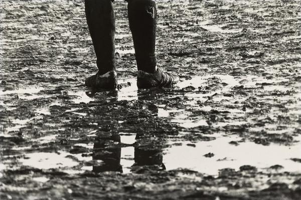 Football Ground, Player standing in Mud