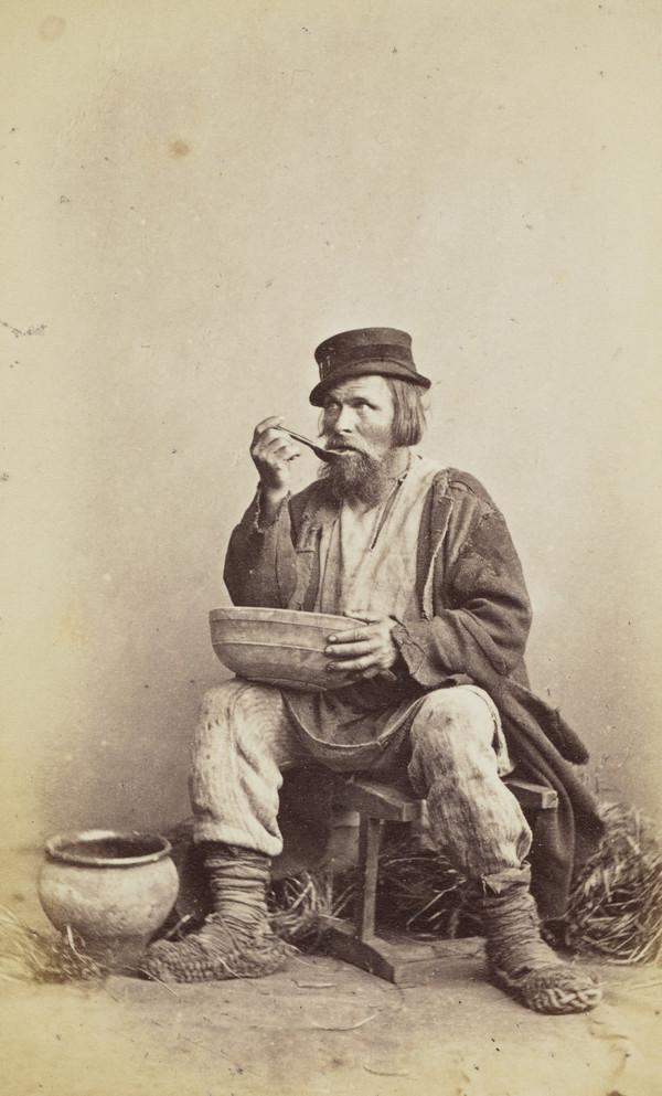 Russian 'type' peasant eating from a bowl