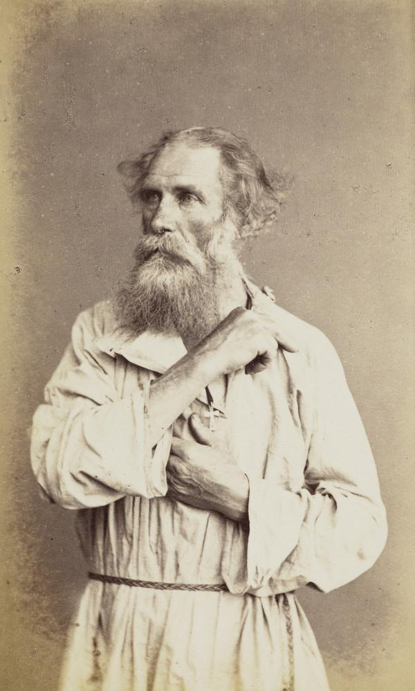 Half-length portrait of an old man ?monk. Wears a cross and seems to be crossing himself