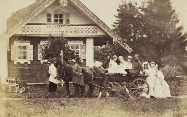Horse and cart with group of men and women, outside house in the country  - ?wedding party