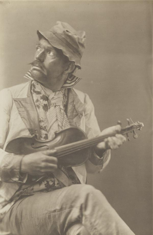 Unknown man in fancy dress as a Negro, with a violin