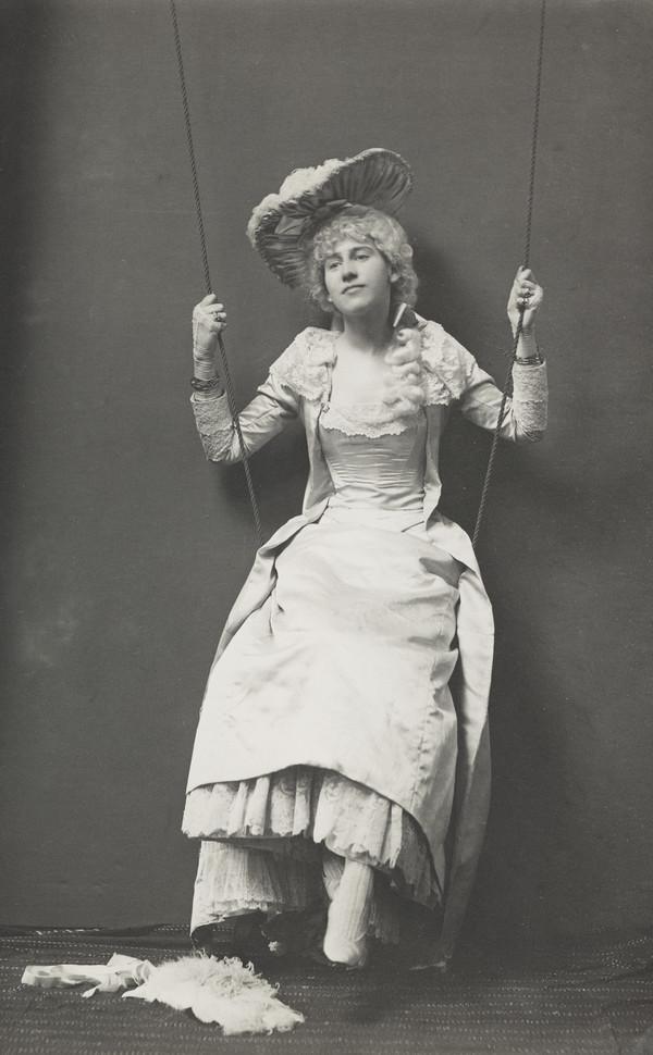 Girl in fancy dress on swing
