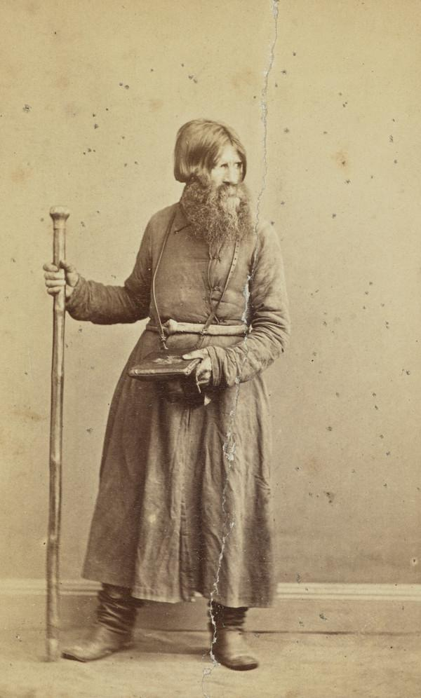 Churchwarden - long shaggy beard, holding prayer book and staff
