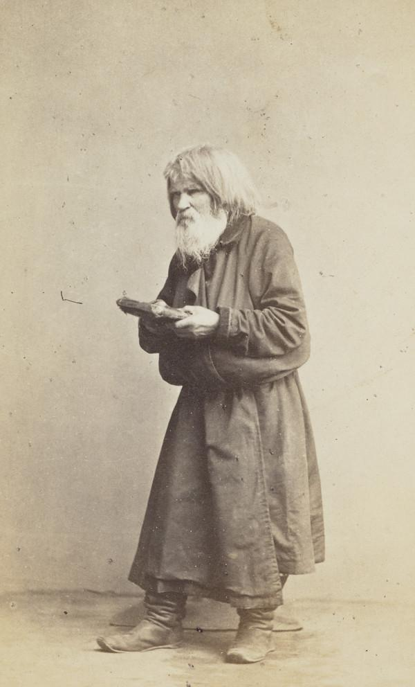 An 'old believer' - religious with beard and long hair, old man holding book