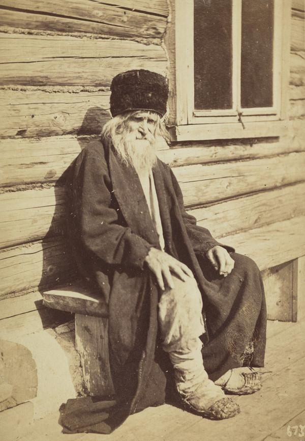 Old peasant man sitting on a wooden bench (1871)