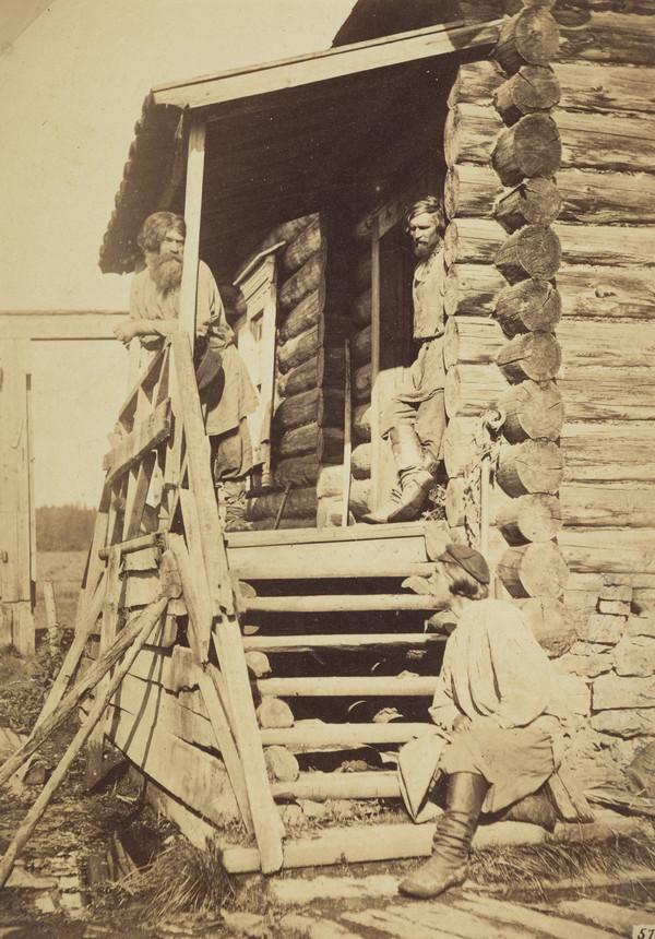 Three peasants on the steps of a house (1871)