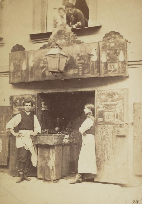 Shopkeepers at fruit shop doorway - ? St Petersburg (1871)