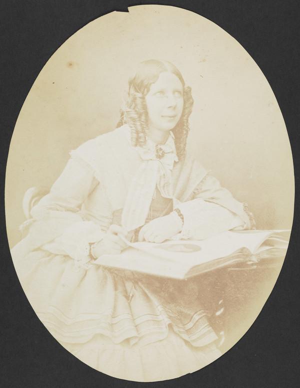 Mrs John Adamson with photograph album