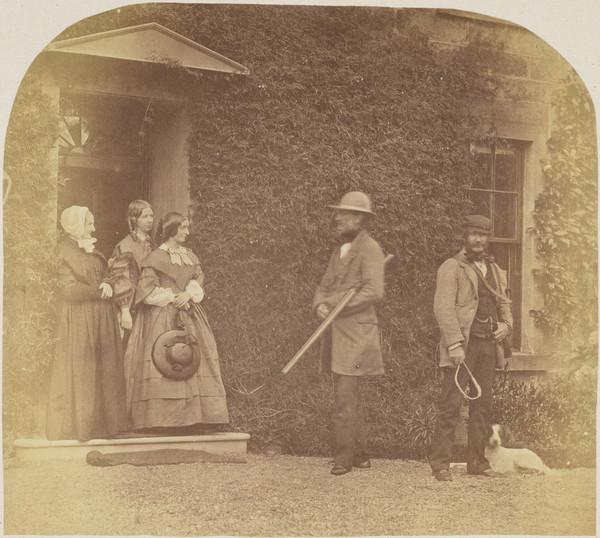 Group - Mrs Alexander, Mrs John Adamson and Miss Alexander, two men and a dog outside