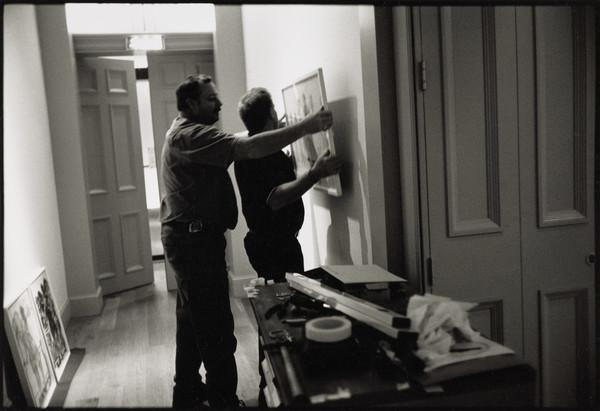 Peter Dalrymple and Stephen Naylor, Art Handling Technicians, hanging the 'Beuys to Hirst' exhibition, the Dean Gallery, Edinburgh (2001)