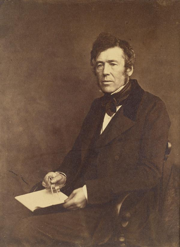 Unknown man holding book and dividers, has been called 'George Meikle Kemp' (About 1855)
