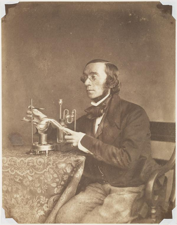 George Wilson, 1818 - 1859. Chemist and religious writer. (With chemical apparatus) (About 1854)