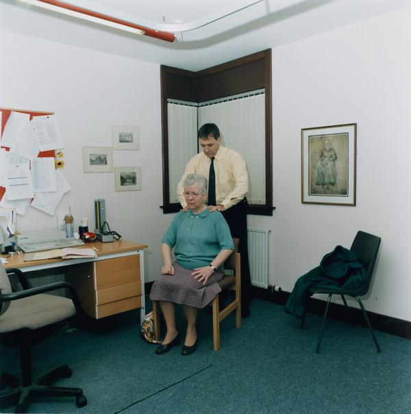 Untitled (Doctor Examining a Seated Patient)