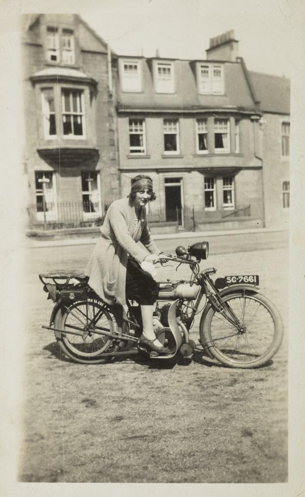 Unknown Woman on Motorbike