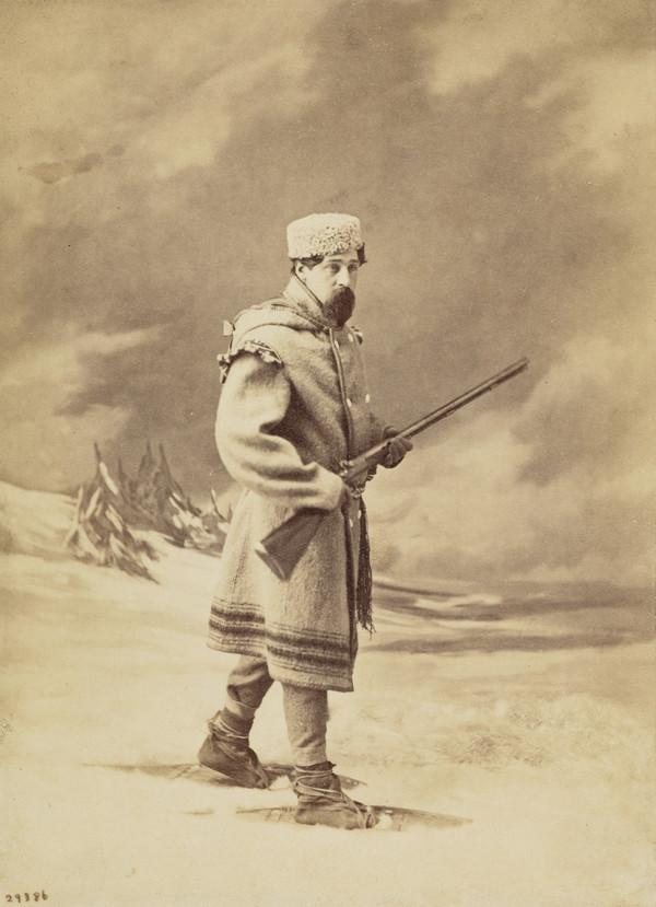'Looking out for game' - hunter in snow