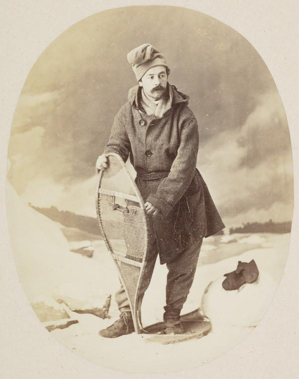 Man with snowshoes (studio photograph with elaborate 'outdoor' set and snow made of salt)