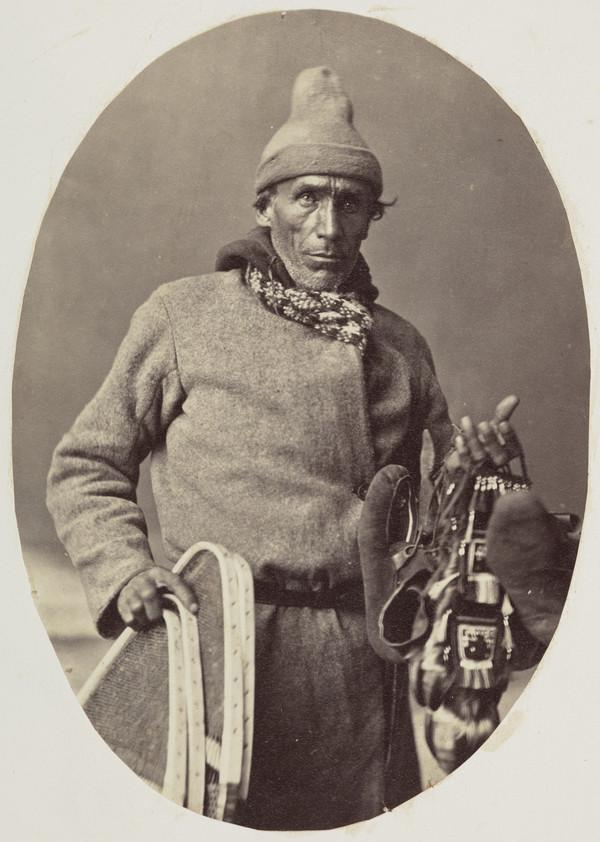 Man holding snowshoes
