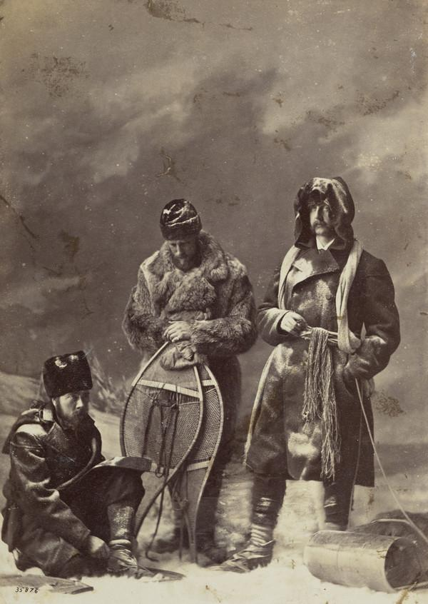 Men with snowshoes (studio photograph with elaborate 'outdoor' set and snow made of salt)