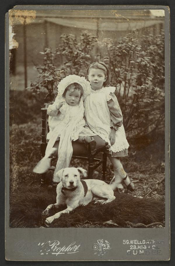 Portrait of Two Young Girls and a Dog