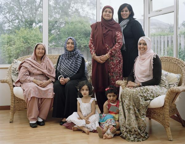 Farkhanda Chaudhry MBE (standing wearing headscarf) with the Women of her Family, Glasgow, 15 May 2011. From A Scottish Family Portrait series (2011)