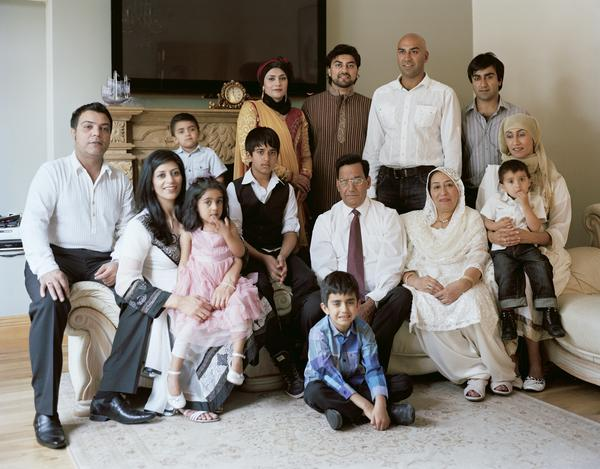 Amar Latif (standing in white shirt) with his Family, Glasgow, 18 June 2011. From A Scottish Family Portrait series (2011)
