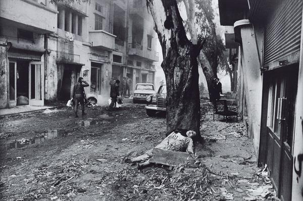 A Dead Palestinian Woman, while in the Background Christian Phalange Fighters were Looting Palestinian Farmers, Beirut (1976 (printed 2013))