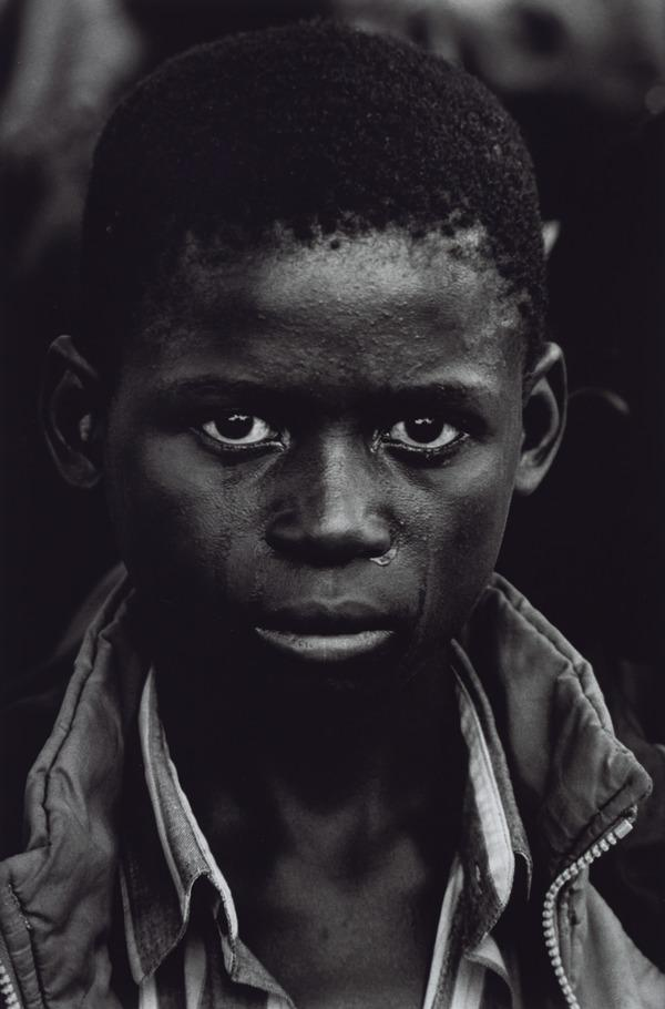 A Boy at the Funeral of his Father who Died of AIDS, Ndola, Kawama Cemetery, Zambia (2000 (printed 2013))