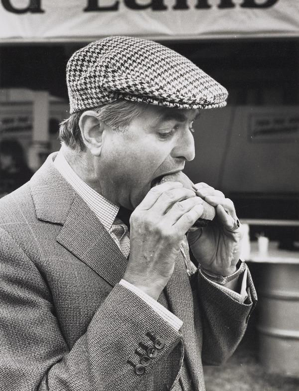 Unknown Man Eating a Burger